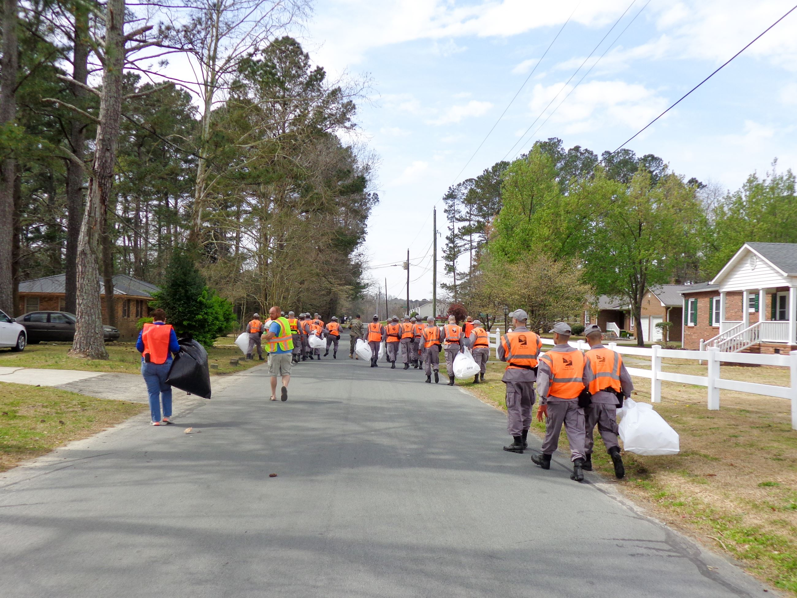 Clean Up Crew Walking on Road